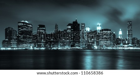 Manhattan skyline by night from Brooklyn bridge park - USA - stock photo