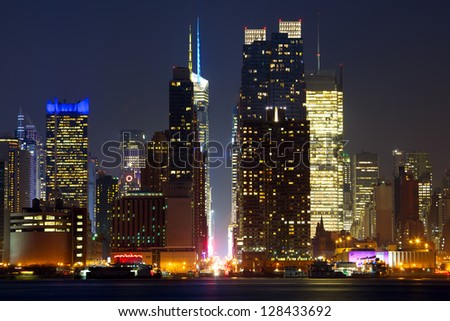 Manhattan skyline looking east along 42nd Street at dusk, New York City - stock photo
