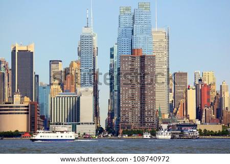 Manhattan skyline looking east along 42nd Street over the Hudson River, New York - stock photo