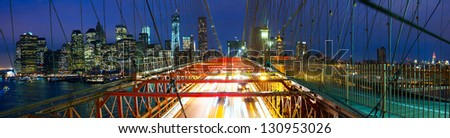 Manhattan skyline panorama from Brooklyn Bridge at dusk, New York City - stock photo