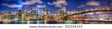 Manhattan skyline panorama with the Towers of Lights (Tribute in Light) in New York City - stock photo