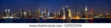 Manhattan skyline panorama with Times Square lights at dusk, New York City - stock photo