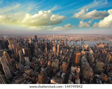 Manhattan skyline - Spectacular aerial view from the Empire State Building at sunset - stock photo