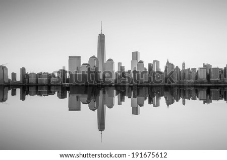 Manhattan Skyline with the One World Trade Center building at twilight, New York City in black and white - stock photo