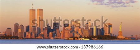 Manhattan skyline with World Trade Center and Statue of Liberty in New York City, NY - stock photo