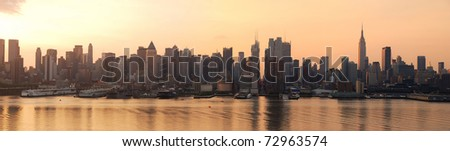 Manhattan urban skyline panorama in New York City with Empire State Building at sunrise over Hudson River - stock photo