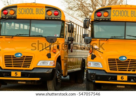 Manheim, PA - January 1, 2017: Parked yellow school buses ready to transport students.