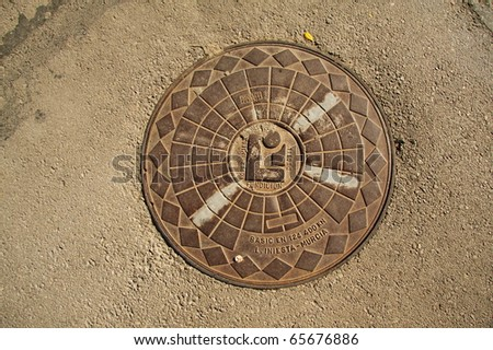 Manhole cover - stock photo