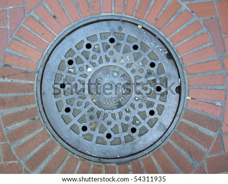 Manhole cover in downtown San Francisco, CA. - stock photo