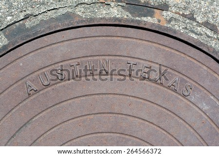 Manhole cover with the words Austin Texas  - stock photo