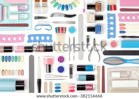 manicure and pedicure tools and other essentials on white background top view. flat lay composition in blue and pink colors - stock photo