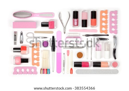 manicure and pedicure tools and other essentials on white background top view. nail work flat lay concept in pink and orange colors - stock photo