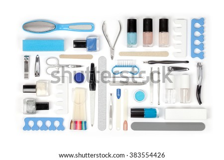 manicure and pedicure tools and other essentials on white background top view. nail work flat lay concept in blue colors - stock photo