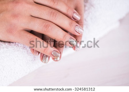 Manicure - Beauty treatment photo of nice manicured woman fingernails.