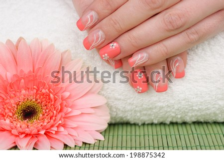 Manicure - Beauty treatment photo of nice manicured woman fingernails. Very interesting nail art with nice pink and white nail polish. Selective focus. - stock photo