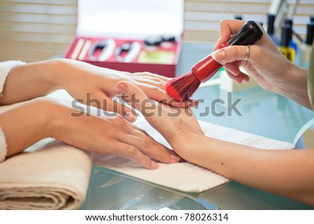 manicure brush cleans nails in a beauty salon manicure
