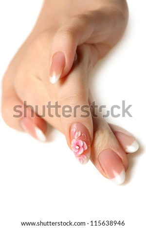 Manicure isolated on white. Well-groomed female hands with a decorative element - a flower