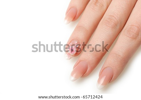 Manicure isolated on white. Well-groomed female hands with a decorative element - a flower - stock photo