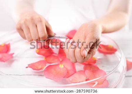 Manicure, nail clipping. The woman cuts the nails, manicure home  - stock photo
