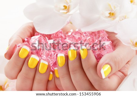 Manicure nail paint yellow color - stock photo