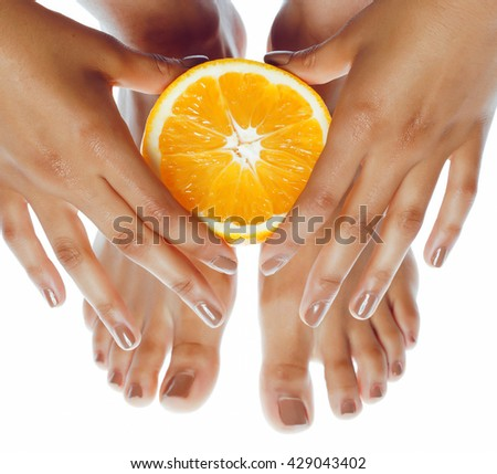 manicure pedicure on afro-american tann skin hands holding orange, healthcare concept - stock photo
