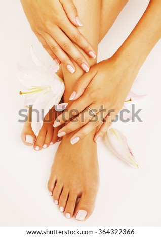 manicure pedicure with flower lily close up isolated on white perfect shape hands
