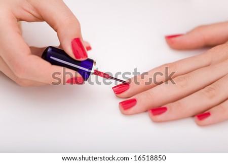 Manicure process. Beautiful female hands. - stock photo