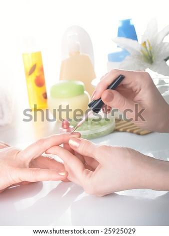 Manicure process. Female hands. - stock photo