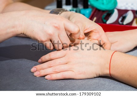 Manicure process in beautiful salon