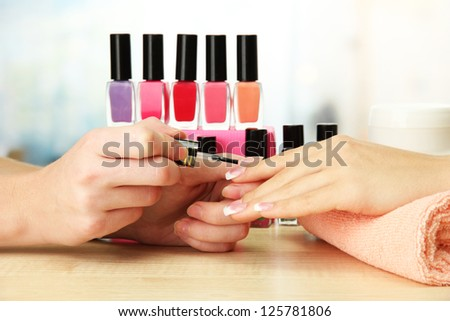 Manicure process in beauty salon, close up - stock photo