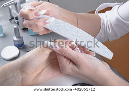 Manicure. Processing of extended nails by a nail file