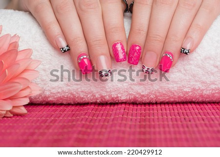 Manicure treatment. Close up of female hands. Very interesting nail art on fingernails.  - stock photo