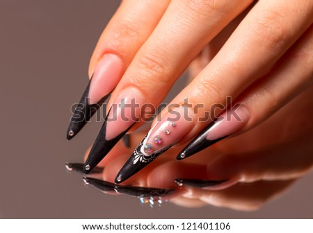 Manicure with reflection in the mirror. Woman fingers