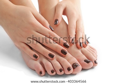 Manicured female feet and hands isolated on white - stock photo