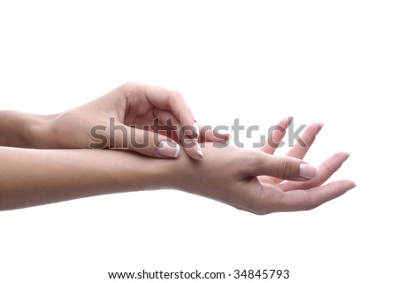 Manicured female hands on white - stock photo