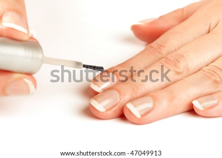 Manicurist Applying Natural Looking Nail Polish Stock Photo (Royalty ...