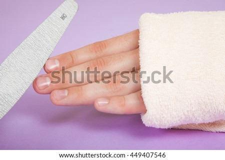 Manicurist doing manicure for man in beauty salon. body care - stock photo