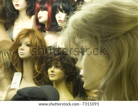 Manikin heads in a wig store - stock photo
