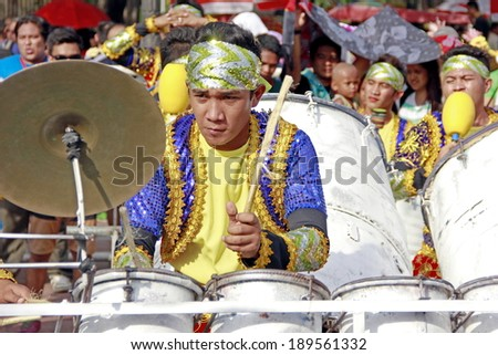 MANILA - APRIL 26: Contingent from different parts of the country celebrate  The 2014 Aliwan Fiesta on April 26, 2014 in Manila Philippines.  Musician play drums during the street dance.  - stock photo