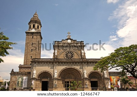 Manila Cathedral with the Intramuros area of manila - stock photo