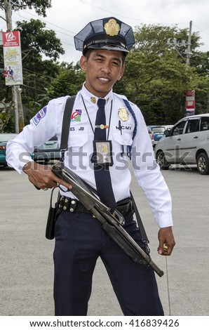 MANILA - FEB 12: An unidentified security guard at a shopping centre on 12 Feb, 14 in Manila. It is estimated there are 3.7 million of security guards including doormen in the Philippines.