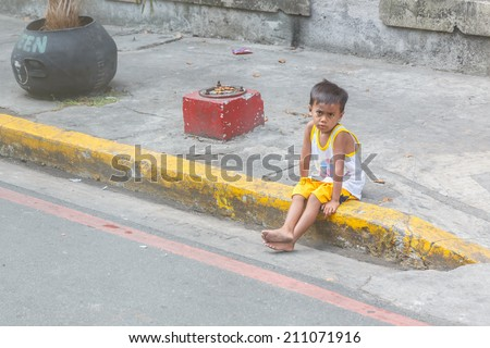 MANILA - FEB 15: Unidentified street of children on 15 Feb, 14 in Manila. Children of the street make their homes on the street which make up 25%-30% of the street children in the Philippines. - stock photo