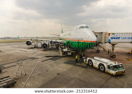 MANILA - FEBRUARY 15: Eva Air Flight at Ninoi International Airport on Feb 15, 14 in Manila, Philippines. It is the airport serving Manila and its surrounding metropolitan area.