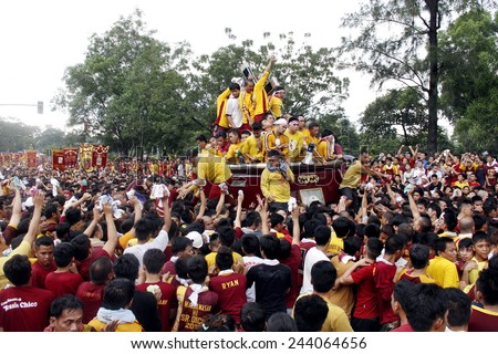 MANILA - JAN. 9: Devotees celebrate the feast of The Black Nazarene on January 9, 2015 in Manila Philippines. The fiesta celebrated with procession of image around the city by million devotees .