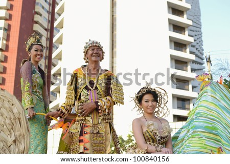 MANILA, PHILIPPINES - APR. 14: parade participants enjoying on their float during Aliwan Fiesta, which is the biggest annual national festival competition on April 14, 2012 in Manila Philippines. - stock photo