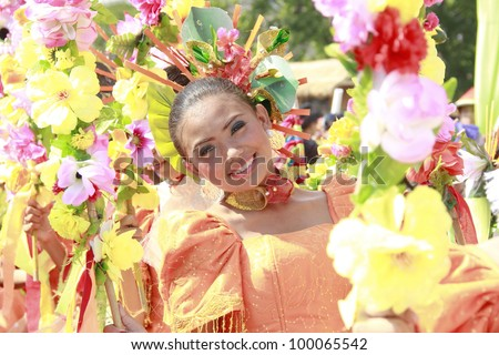 MANILA, PHILIPPINES APRIL 14: Contingent from different part of the country perform in The Aliwan Fiesta on April 14, 2012 in Manila. Aliwan celebrated with beauty pageant & street dance competition. - stock photo
