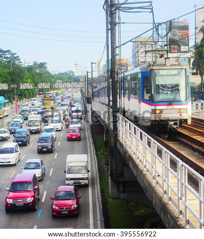 MANILA, PHILIPPINES - APRIL 03, 2012: LRT train on a railroad in Manila, Philippines. LRT serves 579,000 passengers each day. Its 31 stations along over 31 kilometers - stock photo