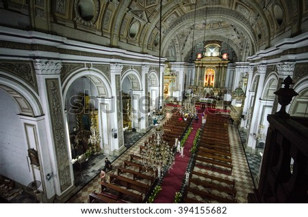 MANILA, PHILIPPINES - AUGUST 28: San Agustin Church on August 28, 2014 in Manila, Philippines. San Agustin is a Roman Catholic church founded in 1571.  It is the oldest church in the Philippines   - stock photo