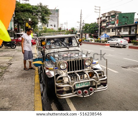 Manila, Philippines - Dec 20, 2015. People taking a jeepney on street in Manila, Philippines. Jeepney is a most popular public transport on Philippines.