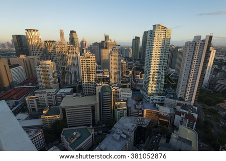 Manila, Philippines -February 23, 2016: Makati City Skyline at sunset . Makati City is one of the most developed business district of Metro Manila and the entire Philippines.  - stock photo